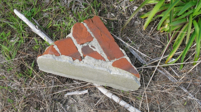 washed up corner of a wall (beach front) for web